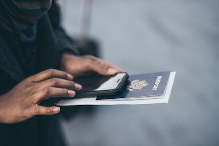 A citizen holds their passport and wonders what will happen after their divorce