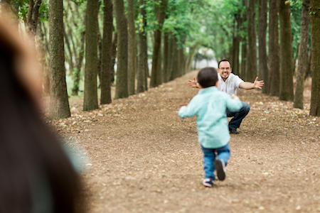 A boy running to his divorced father for a scheduled visitation