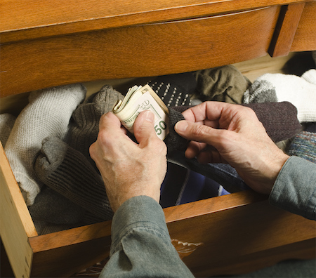 Man hiding money for his divorce in a drawer