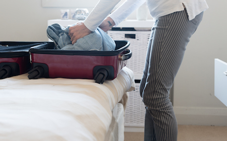 A recent divorcee packs their bags to move to another province