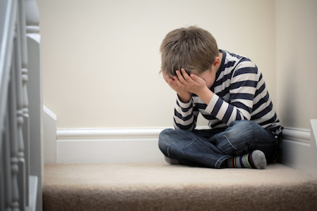 A child reacting due to parental alienation following a divorce