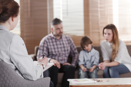 A family receiving counselling for their court order