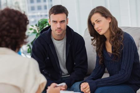 A divorcing couple in divorce mediation