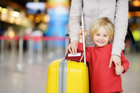 Woman with child at airport